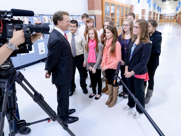 Christal Bookhamer Lowell Milken interviews students
