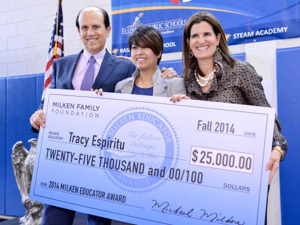Tracy Espiritu with Mike Milken Mary Pat Christie and 25000 check