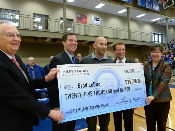 Brad LeDuc, Lowell Milken, Sam Brownback and VIPs with check