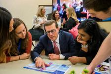Lowell Milken helps Milken Educators choose panels MEA Forum 0324 720x480
