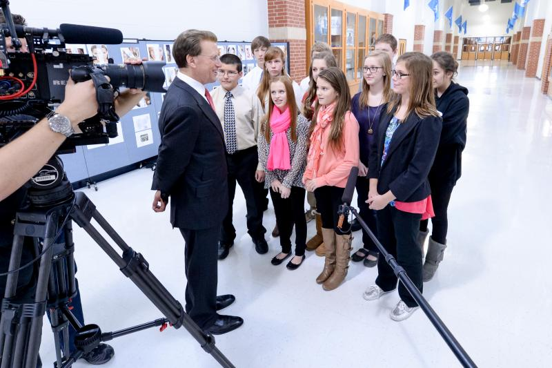 Lowell Milken interviews students at Loflin Middle School